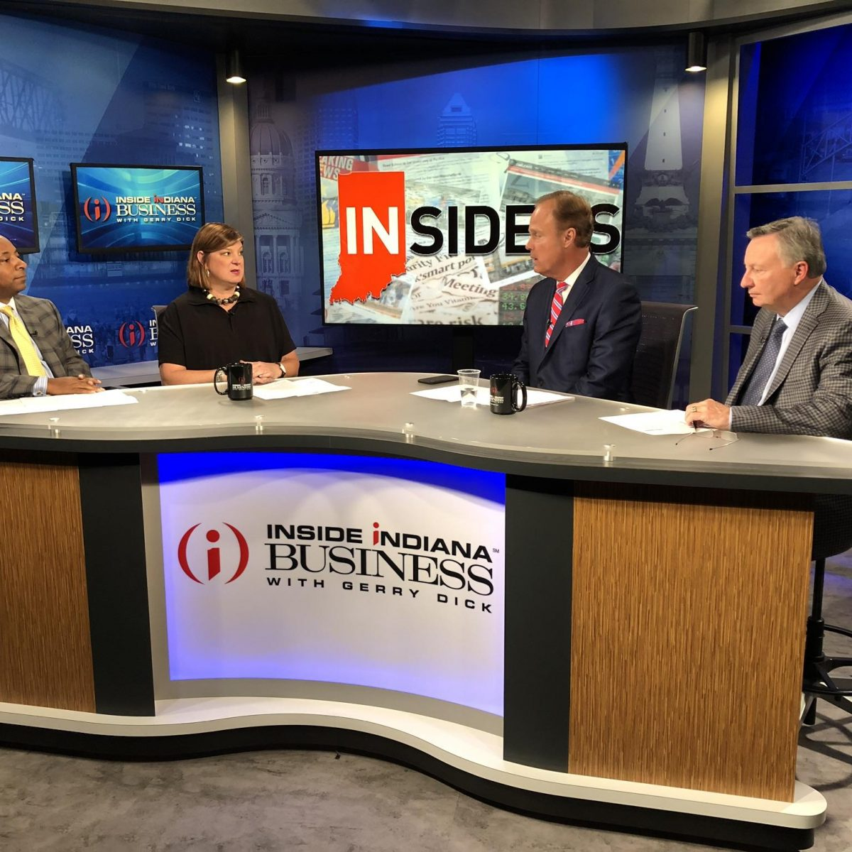 Photograph of Norris Cunningham (co-founding shareholder of Katz Korin Cunningham), Anne Hathaway, Gerry Dick and Frank T Short (left to right) on the set of Inside Indiana Business August 16, 2019